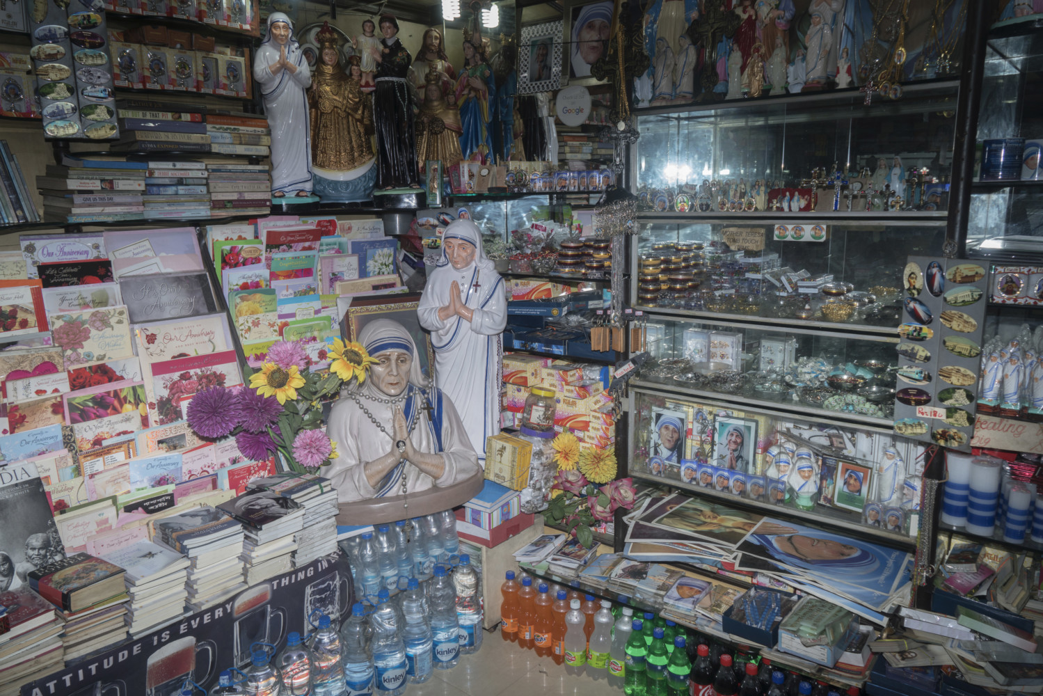 From the Magnum Photos Website: Souvenir shop dedicated to Mother Teresa. It is widely expected that the canonisation of Mother Teresa will lead to larger numbers of foreign tourists inflow and the Indian Association of Tour Operators has urged the West Bengal State Government to promote Kolkata's links to Mother Teresa so as to take advantage of the tourism opportunities. Kolkata, India August 2016. © Sohrab Hura / Magnum Photos.